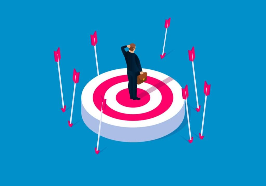 Off-target, failure concept, desperate businessman standing on target without hit