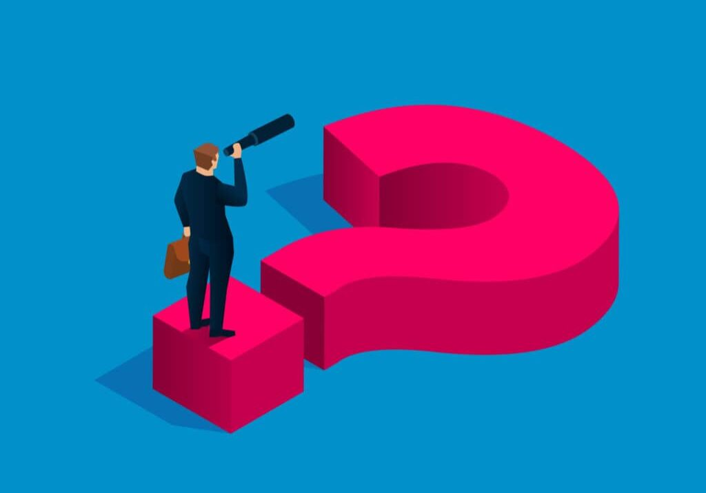 Solving business problems, businessman holding binoculars standing on question mark